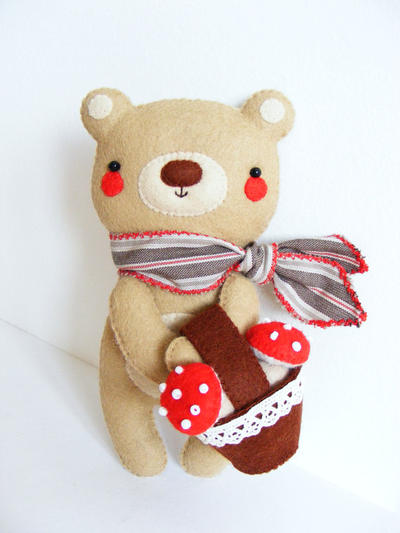 Teddy bear with basket of toadstools