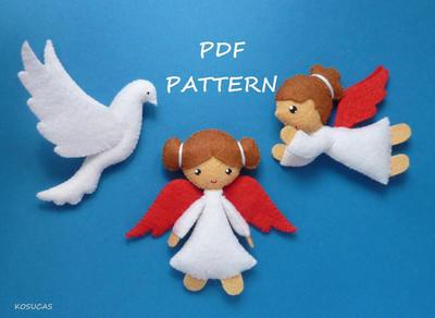 Pequeños angelitos y una paloma de fieltro